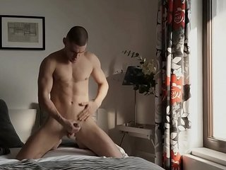 Max Dior is two-fisting his cock as he fucks his hands