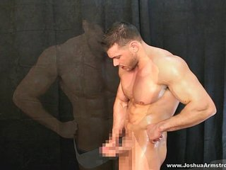 Drenched in oil posing naked with a hard cock