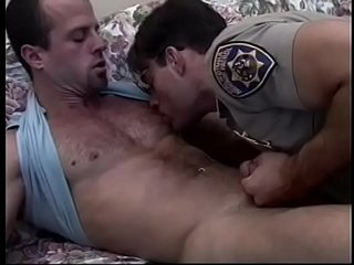 Horny guy on bed gets fucked in the ass by cop